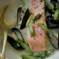 Elegant and surprisingly easy to prepare, the salmon in this dish is immersed in a buttery, wine-and-mussel-infused broth.