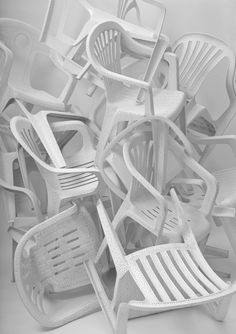 German designer Tina Roeder has just send us pics of her first solo exhibition 'white billion chairs 33' -   a collection of old and rare monoblock chairs (2002-2009), which she has individually perforated   (up to ten thousand holes each) and sanded, in order to give them a new life and appreciation.  This numbered limited edition of 33 unique pieces, you can see at the Appel Design Gallery in Berlin, Germany. 2009.