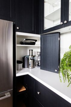 Corner appliance cabinet. 10 Kitchens That Solve the Awkward Corner Conundrum