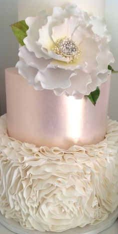 Beautiful pink and white ruffled #cake with flower topper