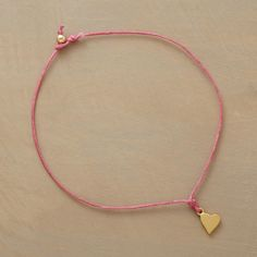 """WISH UPON A HEART BRACELET--A wish made when donning this bracelet is said to come true once the Irish linen cord finally breaks. Exclusive. Handcrafted in USA with heart in sterling silver dipped in either 14kt rose or yellow gold or sterling silver (Cord colors as shown). 7""""L."""