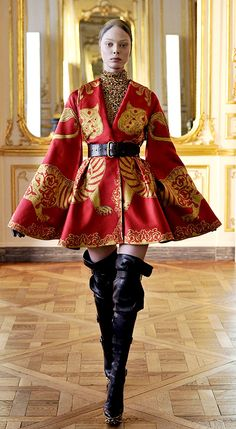 A red dress coat from Alexander McQueen's final collection Fall Winter 2010