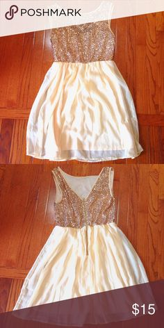 Gold Sequin & Chiffon Mini Dress This was only worn once! It's now way too small for me as it is a juniors sized dress. So pretty. I wore it for an xmas party on year, and I loved it! Really flowy and comfy. The top portion of the dress has gold sequins, all still in tact. The bottom portion has a built-in slip. No rips, stains, or tears of any kind. Smoke free, pet free home  Issi Dresses Mini