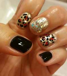Gold, black, and red leopard print mani nail art by @andi425 on IG