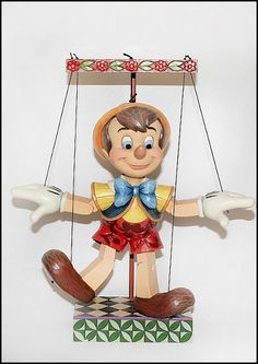 """*PINOCCHIO ~ Jim Shore Disney Traditions  70 Years of Wishing on a Star  Pinocchio Marionette Figure    Specifications:  Size: 13""""H x 3""""W x 6""""L  Materials: Stone Resin  Note: Unique variations should be expected; hand painted"""