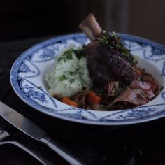 Slow-cooked lamb shanks topped with gremolata and served with a parsley-infused mash.