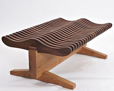 @chicagohomemag  1 of a kind #bench #designed by #David #Stine makes woodworking look easy but no sirree, this remarkable bench like a wooden wave of comfort is art, furniture, a breakthrough in the craft and I want it now