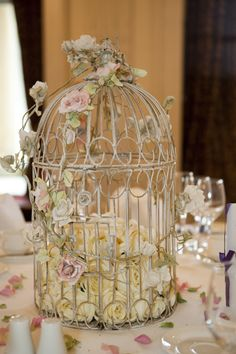 garden style centerpiece with a hint of vintage, i actually find this very classy