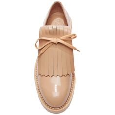 Rendered in a glossy nude patent leather and masterfully crafted in Italy, both quirky and sophisticated, these brogues from Marni echo orthopedics in the most…