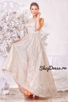 A gorgeous Milagros evening dress, completely studded with glitter, with an open back. This dress in the style of glamour will be appropriate both at the prom and at a social event. As well as a delicate powdery color will certainly appeal to brides.