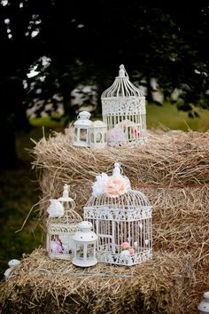 Stacks of hay with vintage birdcages