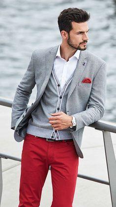 Shop this look on Lookastic:  http://lookastic.com/men/looks/dress-shirt-pocket-square-cardigan-blazer-belt-jeans/9349  — White Dress Shirt  — Red Print Pocket Square  — Grey Cardigan  — Grey Blazer  — Black Leather Belt  — Red Jeans