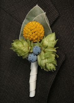 Love this (minus the grapes).. esp the size!  Boutonniere. Craspedia, hops and Oregon grape.