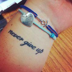 Never give up, tatuaż, Lilou