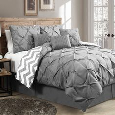 Features:  -Set includes 1 comforter, 2 shams, 2 euro shams, 1 bed skirt, 1 square decorative pillow and 1 boudoir pillow.  -Material: 100% Microfiber polyester.  -Pleating and embroidery for enhanced