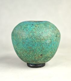 "GORGEOUS HAND-BUILT TURQUOISE GLAZED BULBOUS FORM STONEWARE VESSEL ON BLACK 'DONUT' SHAPED FOOT  (Free Shipping to the Lower 48 States Only)    This is a gorgeous hand-built piece from the current series of hand built turquoise glazed stoneware vessels by California ceramicist David R. Farnsworth. This wonderful BULBOUS FORM STONEWARE VESSEL is 3 1/2"" in height and is approximately 3 3/4"" in diameter. The vessel is covered in a very lovely textured turquoise glaze. Glazed interior.    These…"
