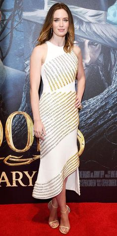 Asymmetric crystal-encrusted David Koma stunner, with pale gold Stuart Weitzman sandals, as worn by Emily Blunt.