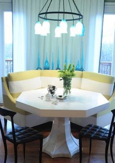 Eclectic Dining Room by Blount Architectual and Interior Design This lovely hexagonal banquette is free standing and fits the table perfectly.
