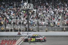 Jeff Gordon taking the checkered flag at the Brickyard July 27, 2014