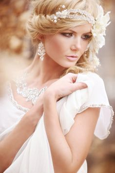 Lovely lovely hair style. Boho & romantic flower and bead head band. And that eye make up.