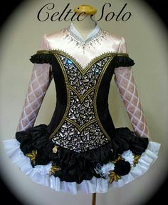 Celtic Solo Irish Dance Solo Dress Costume - I like the mosaic crystals on the bodice and the sleeves. Don't love the skirt.