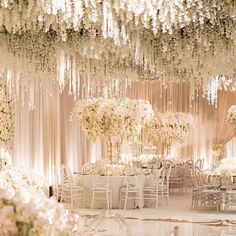 Blown away by the magnificent floral at this wedding- the lush #wisteria coated ceiling was accented with hanging crystals and guests dined at tables with overflowing blush and cream floral #centrepieces #whitelilacinc