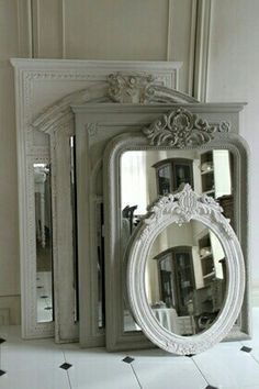 Old picture frames repurposed into mirrors