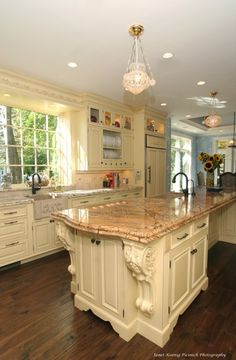 love the large corbels on the island and the monogrammed sink