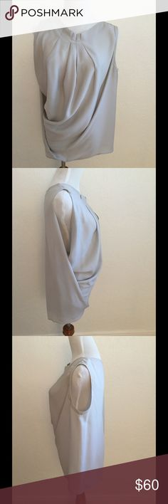Yigal Azrouel silk light gray draped blouse Yigal Azrouel 100% silk light gray draped front sleeveless blouse. Has small pleats at the neckline. In very good condition, the designer label at back of neck has come off. Yigal Azrouel Tops Blouses