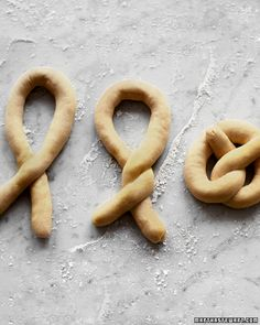 Bake pretzels with your children. Shaped in the traditional prayer form of crossed arms, and traditionally made with unrisen dough, pretzels have been a Lenten tradition since the 300's, according to some sources.