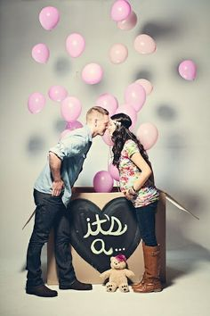 Love this idea!  Your US technician seals the gender in an envelope.  You take the box to the balloon shop.  They fill the appropriate balloons with helium and seal them in the box for you.  Off to the photographer you go!  PST...You could totally do this yourself, with a friend or a timer on your camera.  What a way to get a cool photo and capture a memory.