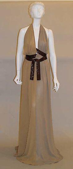 Beige silk chiffon evening dress with beaded wrap belt, by Lars Nilsson for Bill Blass, American, 2002.