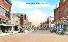 Alpena Michigan MI 1940s Town Second Ave Coca Cola Antique Vintage Postcard Alpena Michigan MI 1940s Downtown along Second Street with Ryan's Tavern Coke sign. Used E. C. Kropp antique vintage postcar
