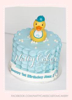 © Natty Cakes Custom Cakery   Rubber ducky birthday cake.  Buttercream petal cake