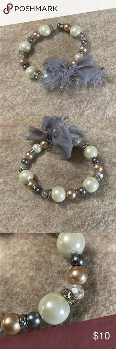 Stretch gray ribbon pearl bead crystal bracelet Stretchy glass bead pearl & crystal beautiful bracelet for a smaller petite wrist. Measures The last photo is a style idea using pieces from my Poshmark Closet~ Jewelry Bracelets Pearl Beads, Crystal Beads, Glass Beads, Pearl Necklace, Crystals, Crystal Bracelets, Jewelry Bracelets, Grey Ribbon, Vintage Inspired
