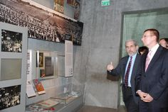 FM of Latvia Edgars Rinkevics (forefront) examines an exhibit in YV's Holocaust History Museum 30/10/12