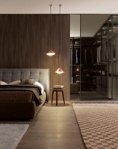 doar partea stanga a imaginii, perete lemn, tablie pat, pat, covorul din stanga