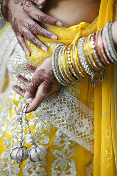 Indian tradition to wear as many glass bangles as you can on each wrist, and once the last bangle breaks the honeymoon is over.