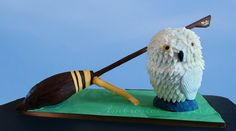 https://flic.kr/p/GZEYYb | Harry Potter Cake | A Harry Potter themed cake featuring the Nimbus 2000 and Harry's snowy owl, Hedwig. The broom's structure was made with a wooden dowel, a wood board, and PVC for the kickstand. The cake part of the broom is vanilla cake with vanilla buttercream, covered with chocolate fondant. Hedwig is made with five layers of vanilla cake and filled with strawberry buttercream, which is made with my homemade buttercream and homemade fresh strawberry puree…