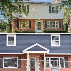 exterior blue siding with red brick homes