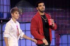 Justin Bieber surprises fans with guest appearance from Drake at Toronto show.