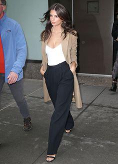 Emily Ratajkowski's white bodysuit, black wide leg pants and trench coat look for less.