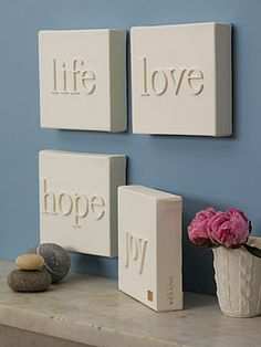 DIY, canvas+wood letters, then paint the whole thing, awesome! Super easy and way cute!  DPESNT HAVE TO BE ON CANVAS, COULD BE WOOD LETTERS ON WOOD  SQUARES COULD BE ANY MATCHING COLOR