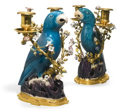 A pair of gilt-bronze-mounted Chinese turquoise and aubergine glazed porcelain parrot candelabra, the porcelain parrots Qing Dynasty, Kanxi period, the gilt-bronze mounts Louis XV, mid 18th century each with a parrot of mirror image modelled standing on a pierced rock base, the birds covered in a rich turquoise glaze and leaving the beak and feet unglazed, the base applied with an aubergine glaze, mounted with gilt-bronze candelabra, further embellished with European porcelain flowers on a…