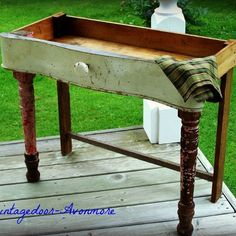 "A lovely old door knob was added to a discarded curvy vintage dresser drawer then teamed up with great pink chippy legs from an old harvest table to make our version of a ""dry sink"". Make a great chair side table - things wouldn't fall off."