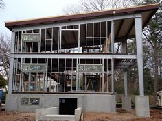 EcoSteel was tasked with creating a custom prefabricated steel home with copious interior space inside a x footprint. See how we got the job done. Steel Frame House, Steel House, Facade Architecture, Sustainable Architecture, Steel Siding, Metal Building Homes, Green Building, House On Stilts, Casas Containers