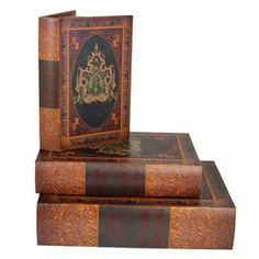 Set of 3 faux leather book boxes with ornate damask detail.