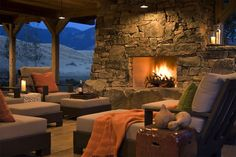 Massive native Montana rock stacked stone fireplace in the outdoor patio/porch