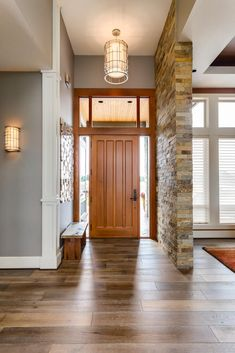 The stone accent wall provides texture and interest to this small, entrance space. #accent #stone #nice