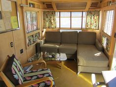 LOVE the interior on this, love this couch for a small space and seperate chair love the light coloured wood paneling - 60s caravan interior